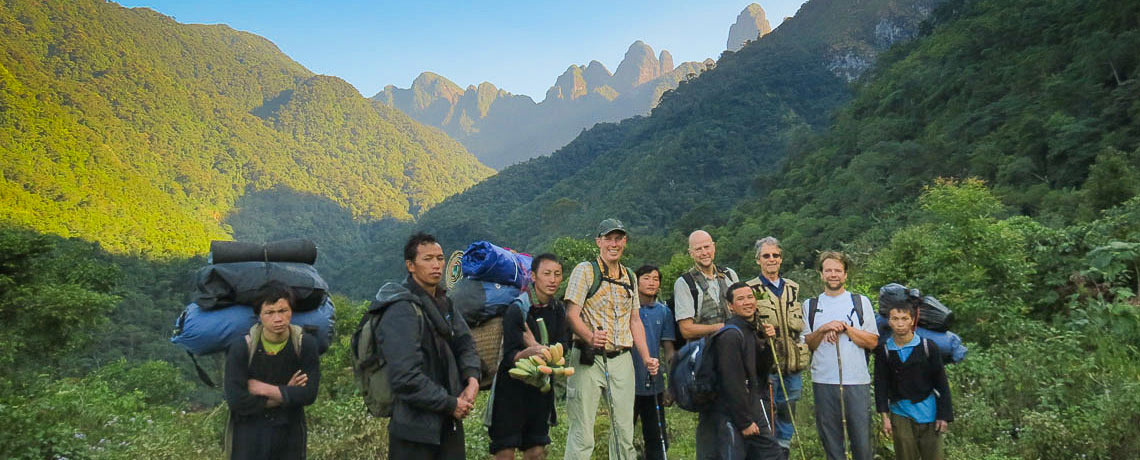 Dan Hinkley and fellow trekkers with rugged mountains in background